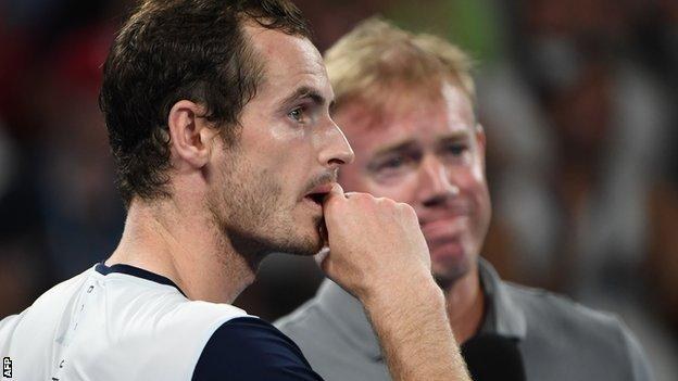 Andy Murray watches the video montage of messages from current tennis players on court at the Melbourne Arena