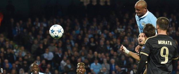 Vincent Kompany played his part in City's opening goal, but left the field with a calf injury 18 minutes later