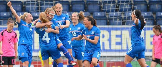 Iceland's Katrin Jonsdottir (5) celebrates with teammates after she scores her side's third