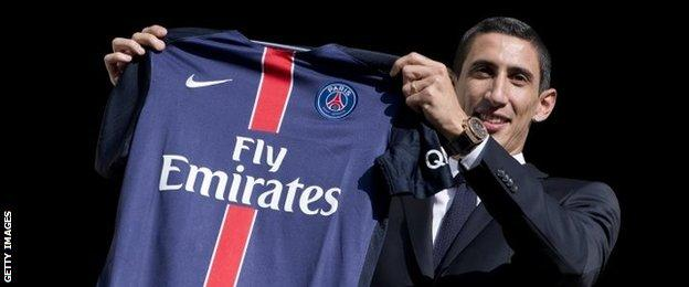 Angel Di Maria with a PSG shirt after signing