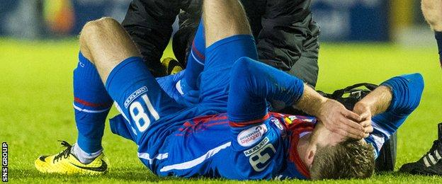 Alex Fisher was hurt after coming on as a second-half substitute