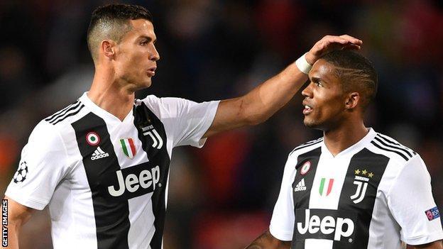 Cristiano Ronaldo and Douglas Costa