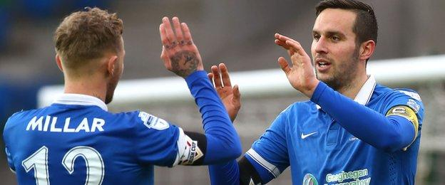 Blues skipper Andrew Waterworth celebrates his third goal against Armagh