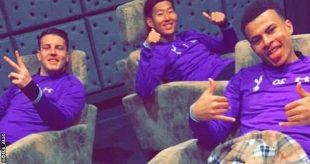 Dele Alli (right) relaxes with team-mates