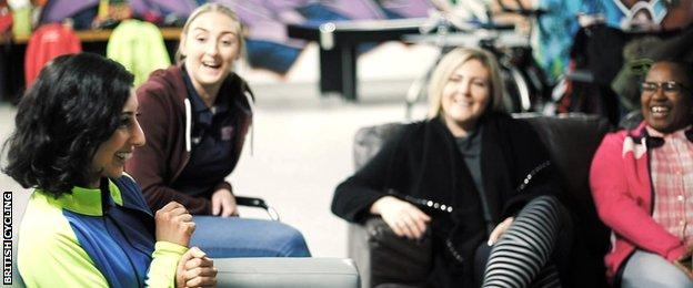 Selma (far left) from Manchester, tells her cycling story to other women