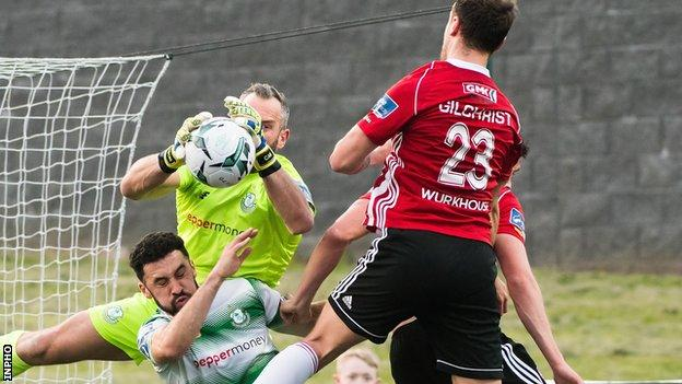 Rovers keeper Alan Mannus comes out to deny Derry's Ally Gilchrist in Friday night's game