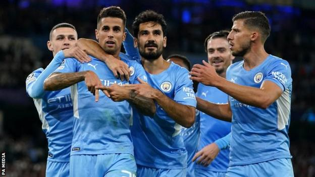 Manchester City's players celebrate scoring against RB Leipzig in the Champions League