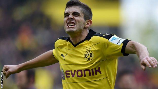 Christian Pusilic's opener helped Borussia Dortmund beat Hamburg