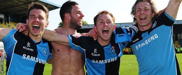 Wycombe celebrate avoiding relegation in 2013-14