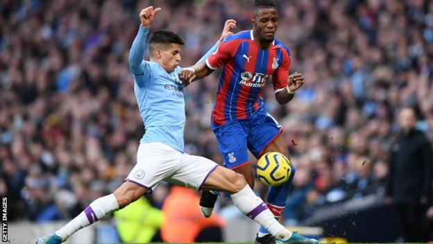 Joao Cancelo in action for Manchester City against Crystal Palace in the Premier League
