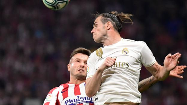 Real stay top of Liga after draw with Atletico in Madrid derby