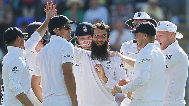 England all-rounder Moeen Ali celebrates with team-mates after taking a wicket during the first Test of the 2015 Ashes