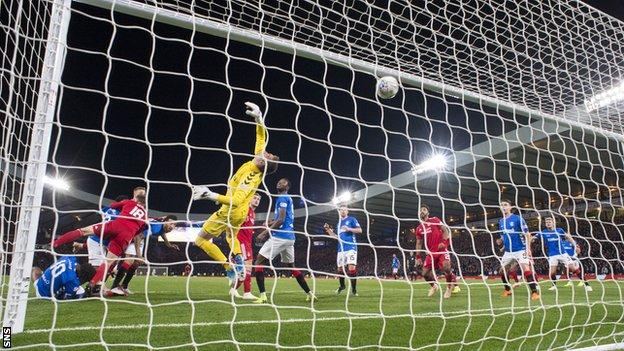 Lewis Ferguson scores for Aberdeen in the League Cup semi-final against Rangers