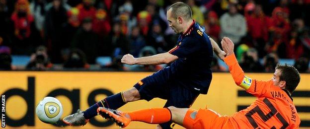Barcelona's Andres Iniesta (left) scores Spain's winning goal in the 2010 World Cup final against Netherlands