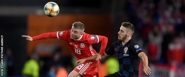 Joe Morrell of Wales beats Croatia's Nikola Vlasic to the ball in October 2019's UEFA Euro 2020 qualifier