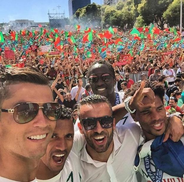 Cristiano Ronaldo (left) and team-mates pose for a photo in front of Portugal fans