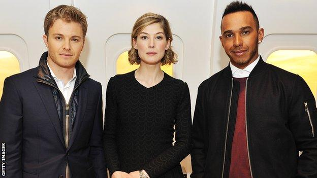 Actress Rosamund Pike separates Nico Rosberg and Lewis Hamilton