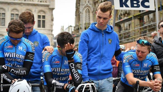 Veranda's Willems-Crelan riders are comforted during a minute's silence to remember Michael Goolaerts