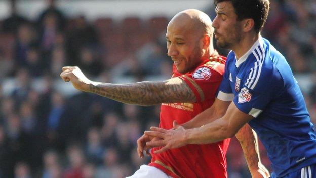 Kelvin Wilson of Nottingham Forest (L) and Maxime Colin of Brentford
