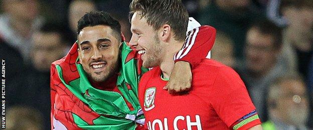 Chris Gunter and Neil Taylor celebrate a Wales win