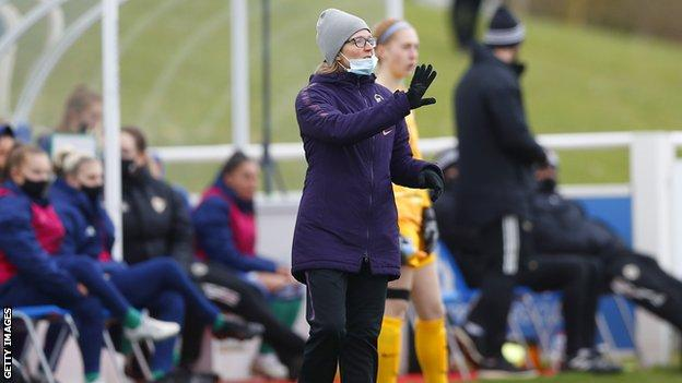 Hege Riise on the touchline managing England