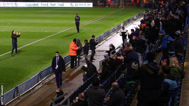 Wycombe manager Gareth Ainsworth (left) receives adulation from the club's fans