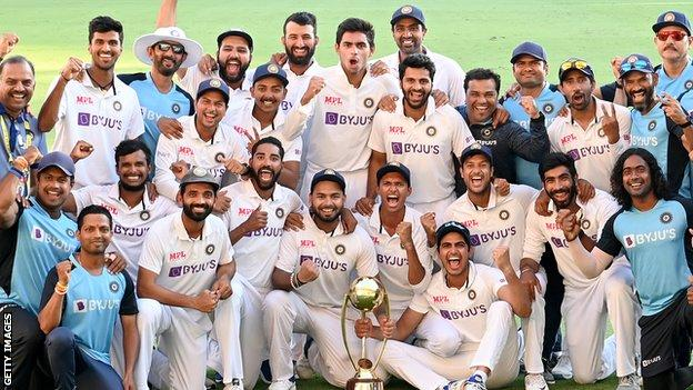 The India players celebrate their 2-1 Test series win over Australia