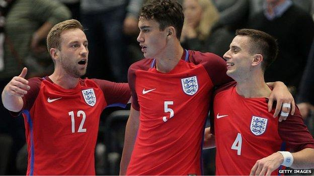 Wolves defender Max Kilman (centre) played 25 times for the England futsal team