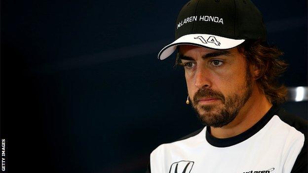 Fernando Alonso looking glum
