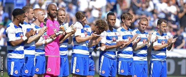 Reading players during a minute's applause in memory of Eamonn Dolan