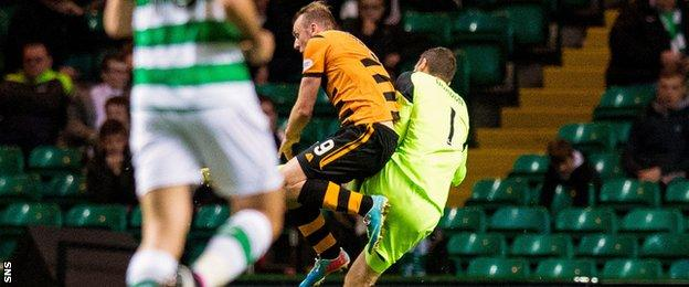 Alloa's Greig Spence is fouled by Celtic's Craig Gordon