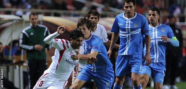 Sevilla's Ever Banega vies with Rijeka midfielder Ivan Mocinic