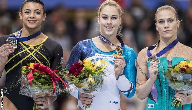 Ellie Downie (left) celebrates winning silver