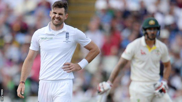James Anderson holds his side
