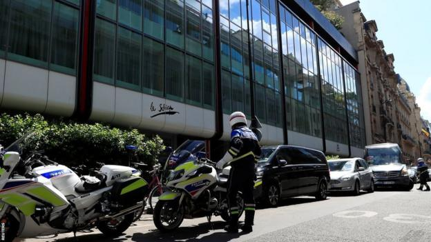French police in front of the Hotel de Berri in Paris after Confederation of African Football president Ahmad was questioned by authorities last week.