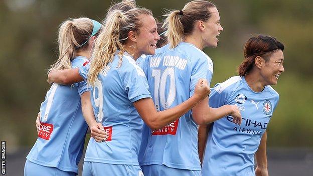 Claire Emslie of Melbourne City celebrates with teammates after scoring her team's first goal during the W-League semi final