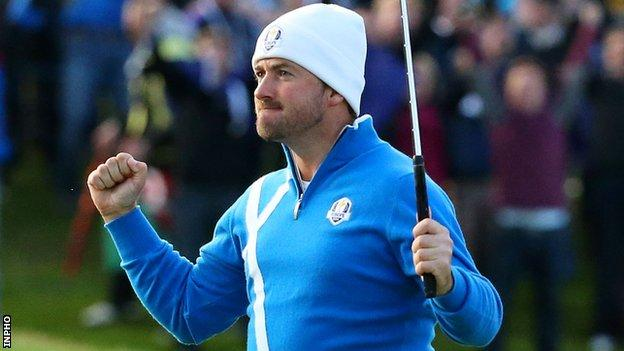 Graeme McDowell celebrates holing a putt in the 2014 Ryder Cup at Gleneagles