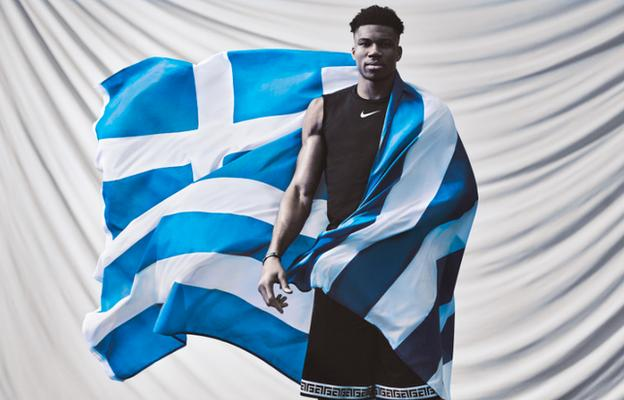 Giannis poses with a Greek flag for promotional Nike photoshoot
