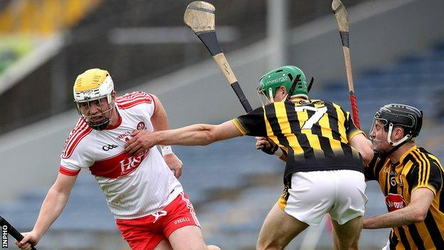 Derry's Ruairi McCartney attempts to evade Kilkenny pair Jason Cleere and Tommy Walsh in the semi-final