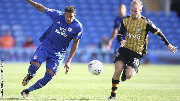 Nathaniel Mendez-Laing of Cardiff City gets away from Barry Bannan of Sheffield Wednesday