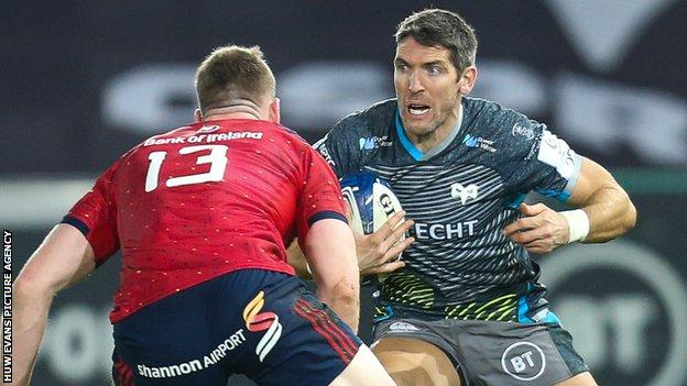 Ospreys replacement James Hook takes on Munster's Chris Farrell