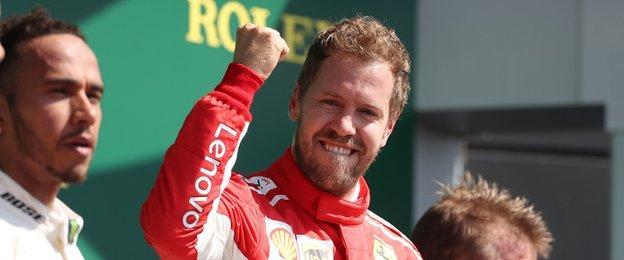 "Ferrari""s Sebastian Vettel (centre) celebrates victory on the podium, with Mercedes"" Lewis Hamilton (left) and Ferrari""s Kimi Raikkonen (right) during the 2018 British Grand Prix"