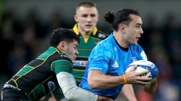 Leinster wing James Lowe is tackled by Northampton's Connor Tupal at the Aviva Stadium