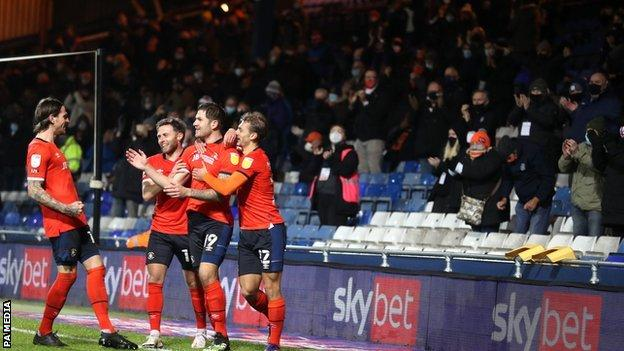 James Collins has scored four of his six goals this season at Kenilworth Road and all against Norwich City - but this was the first he has celebrated with the fans