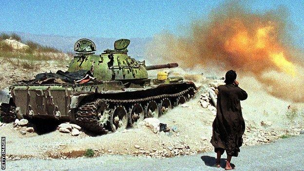 A Taliban tank takes part in a 1998 attack in the north of Kabul to clear the Salang highway, which leads to -the city of Mazar-i-Sharif
