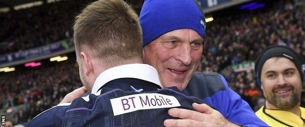Scotland coach Vern Cotter hugs full-back Stuart Hogg in celebration after the victory over Wales
