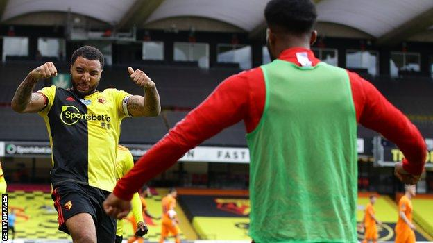 Troy Deeney celebrates after scoring his second penalty against Newcastle