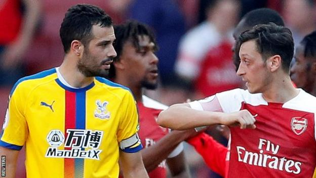 Arsenal's Mesut Ozil and Crystal Palace's Luka Milivojevic talk after Palace's 3-2 win at Emirates Stadium