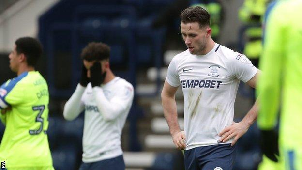 Preston midfielder Alan Browne dejected after missing a penalty