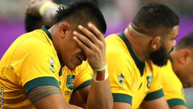 Australia players dejected after defeat by England